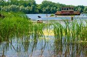 stock photo of nuclear disaster  - Wrecked abandoned ship on a river after nuclear disaster in Chernobyl Ukraine - JPG