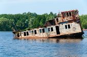 pic of nuclear disaster  - Wrecked abandoned ship on a river after nuclear disaster in Chernobyl Ukraine - JPG