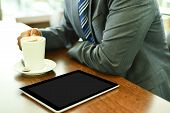 stock photo of coffee crop  - Digital tablet with blank screen in coffee shop
