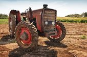 foto of tractor  - An old tractor still functioning and used to clean and harvest the fields  Sicily during summertime - JPG