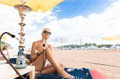 picture of hookah  - Woman with hookah on the beach in bikini - JPG