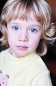 Portrait Of Little Girl With Blue Eyes