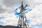 stock photo of electricity pylon  - metal electricity pylon transmit electricity on the sky background city - JPG