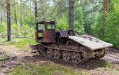 picture of skidder  - Old skidder at the forest in summertime - JPG