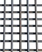 image of reinforcing  - Bunch of several reinforcement bars isolated on white background - JPG