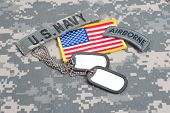 stock photo of army  - US ARMY airborne tab with blank dog tags on camouflage uniform - JPG