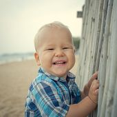 foto of laughable  - Cute caucasian baby laughing - JPG