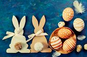 stock photo of easter eggs bunny  - Two Easter bunny and easter eggs on a blue background - JPG