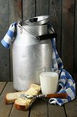 pic of milk products  - Retro can for milk with fresh bread and glass of milk on wooden background - JPG