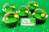 image of pot gold  - St Patricks Day rainbow pot of gold cupcakes with greeting card on a green background - JPG