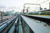 stock photo of high-speed train  - White high speed commuter train with motion blur - JPG