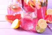 pic of pitcher  - Pink lemonade in glasses and pitcher on table close - JPG