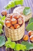 stock photo of cobnuts  - hazelnuts on a table - JPG