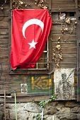 foto of crescent  - Turkish flag on a wall in Istanbul is a red flag featuring a crescent with a star - JPG