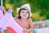 picture of toboggan  - Baby kid girl with hat in summer on green field background - JPG