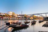 foto of dom  - Traditional boats in the Douro River near Dom Luis Bridge in Porto city - JPG