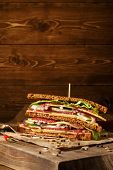 picture of sandwich  - One piece of sandwich on old papper with big cutting board - JPG