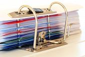 picture of levers  - ring binder macro with many paper files  - JPG