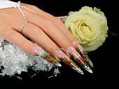 stock photo of nail-design  - Female hand with beautiful wedding design on nails - JPG
