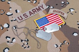 stock photo of sniper  - US ARMY sniper tab with blank dog tags on camouflage uniform - JPG