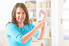 stock photo of karate-do  - Woman doing EFT on the karate chop point - JPG