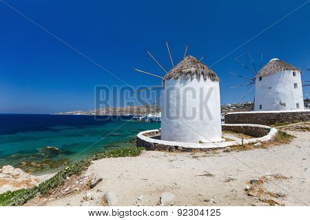 White greek windmills overlooking Little Venice popular tourist destination at traditional village on Mykonos Island, Greece, Europe, White greek windmills overlooking Little Venice popular tourist destination at traditional village on Mykonos Island, Greece, Europe