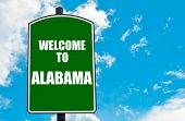 stock photo of alabama  - Green road sign with greeting message Welcome to ALABAMA isolated over clear blue sky background with available copy space - JPG