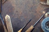stock photo of workbench  - Workbench metal table with old tools - JPG