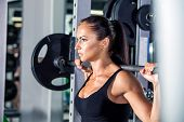 stock photo of barbell  - beautiful sports fitness girl with a barbell in the gym - JPG