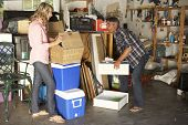 image of yard sale  - Couple Clearing Garage For Yard Sale - JPG