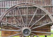 image of wagon wheel  - Wheel and the remains of an old wooden wagon - JPG