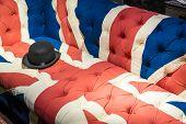 foto of bowler hat  - British Union Jack Flag style modern cushioned sofa with black felt bowler hat - JPG