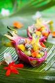 picture of dragon fruit  - Exotic fruit salad served in half a dragon fruit - JPG