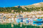 picture of greek  - Colorful boats in small port on Greek Island - JPG