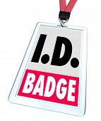 stock photo of credential  - ID Badge words on a plastic name tag on lanyard to illustrate credentials or official pass or entry card for access to a classified area - JPG