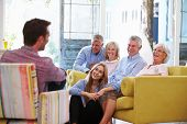 foto of extended family  - Extended Family Group At Home Relaxing In Lounge - JPG