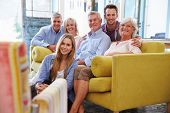 picture of extended family  - Extended Family Group At Home Relaxing In Lounge - JPG