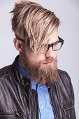 stock photo of down jacket  - Portrait of a young hipster man looking down - JPG