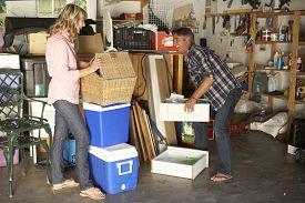 stock photo of yard sale  - Couple Clearing Garage For Yard Sale - JPG