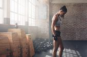 Muscular Female Athlete Standing At The Gym poster