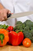 image of cutting board  - assorted fresh vegetables on cutting board with chefs  - JPG