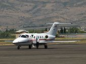 pic of cessna  - Cessna private jet at rural airport with pilot inspecting airplane - JPG