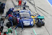 SEPANG - JUNE 19: Lexus Team Zent Cerumo's pit crew prepares to refuel and change tires during a pit