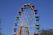 Ferris Wheel. Ferris Wheel In The City Park. Seats For Passengers On The Ferris Wheel. poster