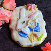 Glazed Cookie As A White Rabbit With Golden Clocks From Fairy Tale Is On A Dark Background, Alice In poster
