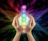 Sending The Seven Chakras Vortex Healing Energy - Female Parallel Hands Against A Multicoloured Back poster