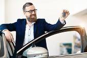 Happy Buyer In Car Dealership. Car Dealership. poster