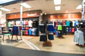 Blurred Interior Of Sports And Fitness Clothing Store In America poster