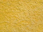 Сoncrete Of Yellow Plastered Wall. Yellow Plastered Wall Texture Grunge Background. Beautiful Decora poster