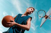 Sports And Basketball. A Young Teenager In A Black Tracksuit Stands With A Ball In His Hands And Pre poster